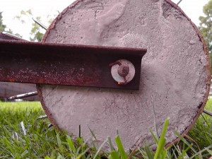 Side view of the concrete, washers and cotter pin